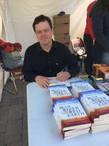 Stephen signs copies of Blue River and Red Earth at the Cormorant Books booth at the Word on the Street Festival, Toronto, 2018.